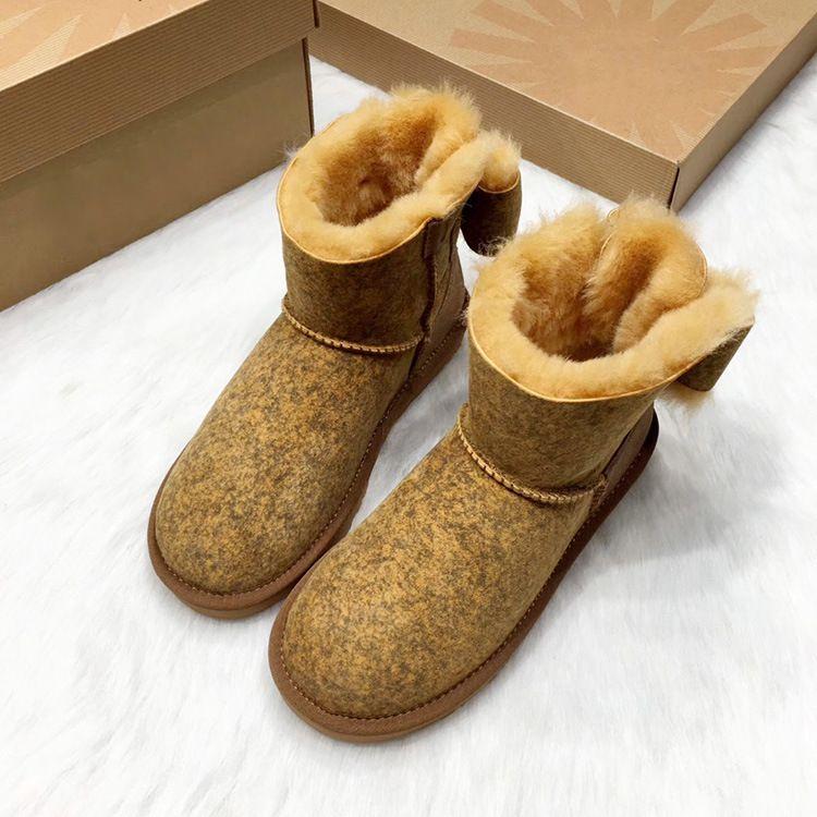 外贸批发羊皮毛一体雪地靴女短筒 加厚保暖蝴蝶结平底防滑女靴