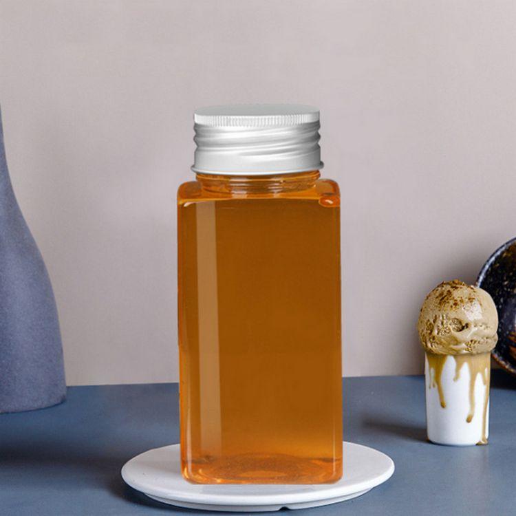 江苏幸福花淮安350ml方形塑料奶茶瓶50个起订 并且保证与当时市场上同样主流新品一致