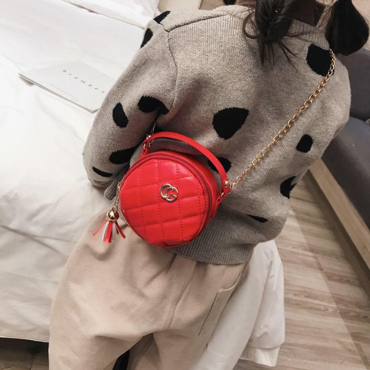 流苏包2018新款潮流韩版时尚儿童单肩包简约PU纯色小圆包一件代发