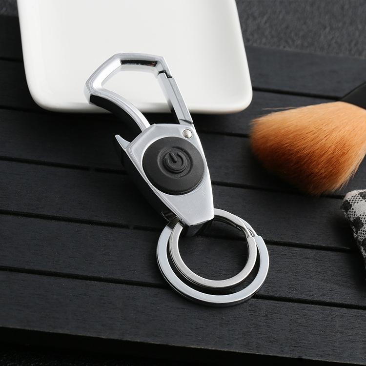 新品不锈钢按钮可发亮发光盾牌钥匙扣 服饰箱包配件定制厂家直销