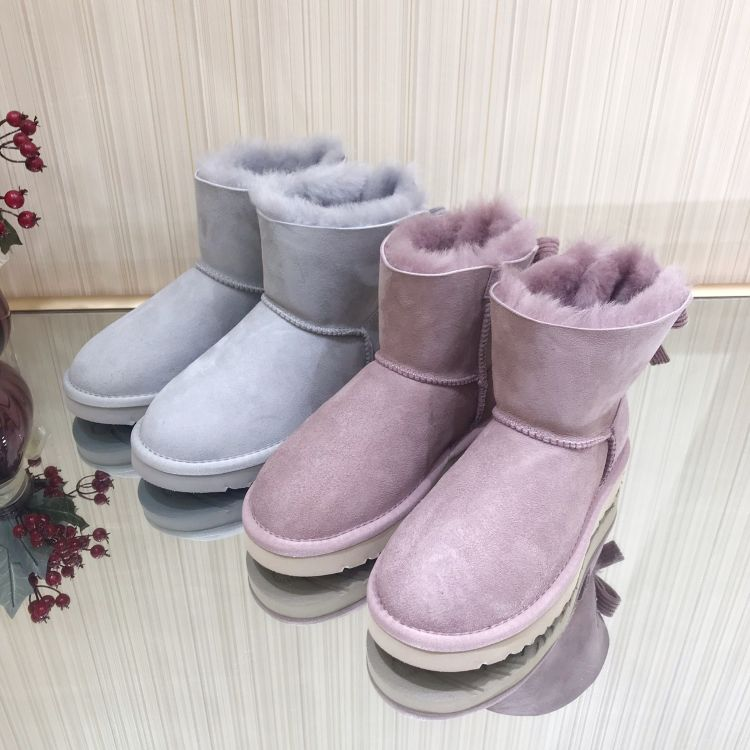 澳洲新款防水羊皮毛一体雪地靴女真皮灯芯绒蝴蝶结羊毛女短靴6057