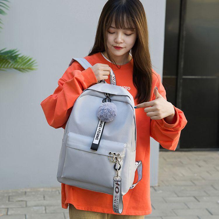 厂家定制纯色毛球挂件帆布双肩包女韩版休闲学生书包户外街拍背包