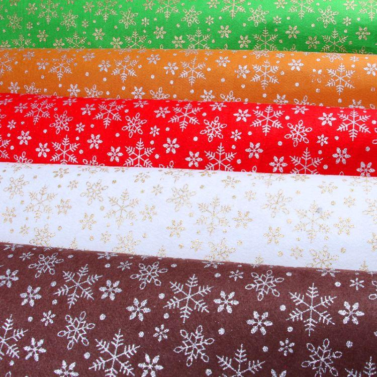 格力特印花不织布 圣诞节 单色雪花图案撒葱粉无纺布 颜色可定做