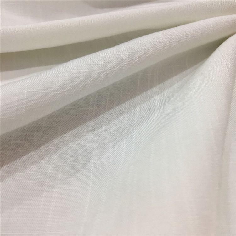柯桥厂家人棉面料人造棉竹节绵绸布料仿麻粘胶面料女装连衣裙新款