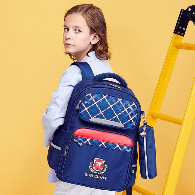 书包小学生男孩2-3-6年级减负护脊双肩背包防水透气耐磨儿童包女