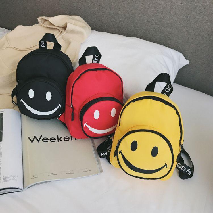 儿童包包2018新款时尚休闲双肩包百搭可爱笑脸幼儿园书包一件代发