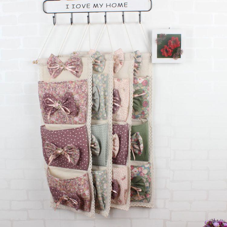 厂家批发时尚蝴蝶结多层布艺收纳挂袋 壁挂袋 门后收纳挂袋 挂袋