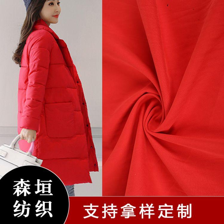 长期大量供应弹力羽绒棉服加厚服装用布四季涤棉胚布面料