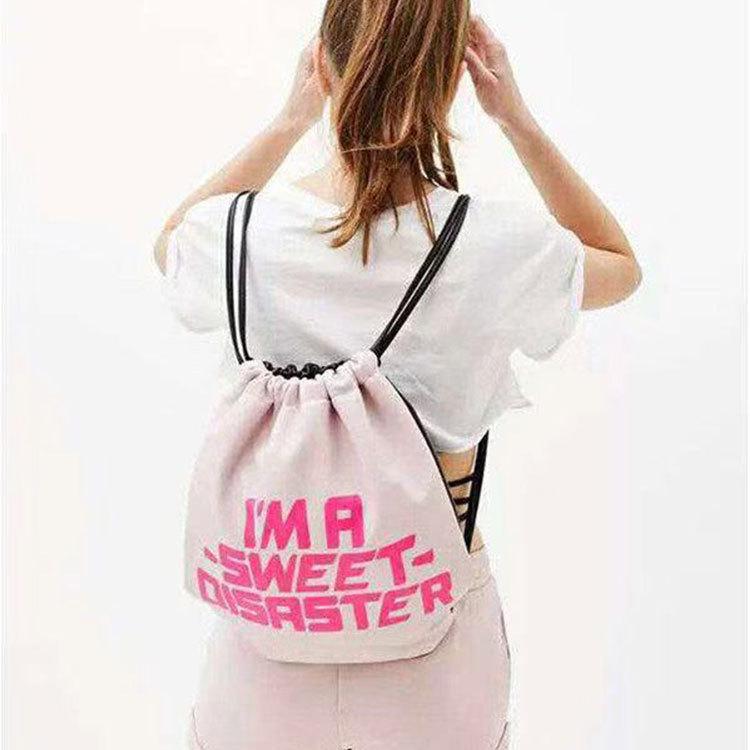 西班牙少女可爱粉色字母印花女士背包 韩版纯色系绳包抽绳双肩包