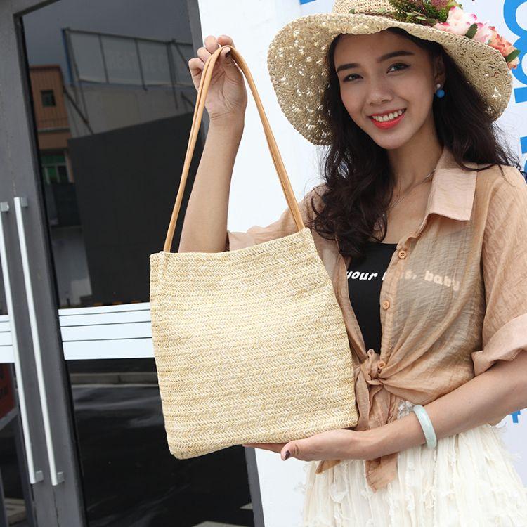 韩国同款编织草编包单肩休闲夏季新款百搭水桶手提女包东南亚风格