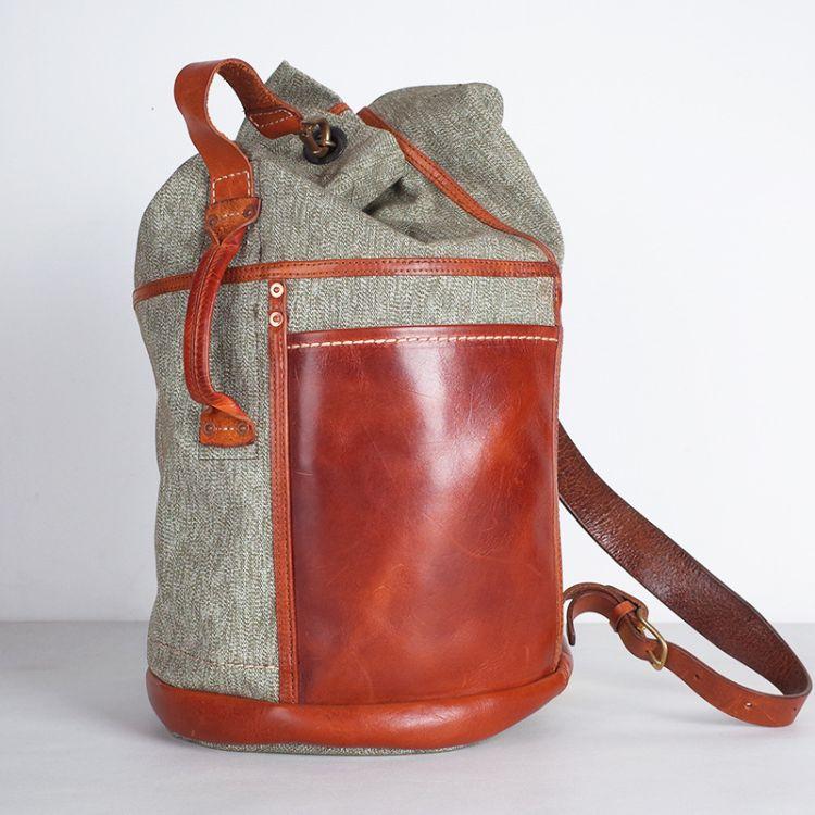 战术双肩背包大容量战复刻男女胡椒盐帆布背包意大利植鞣皮筒包