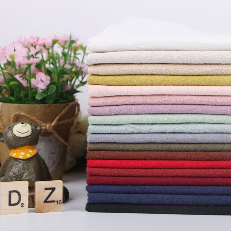 现货供应春夏款休闲衬衫套装全棉素色仿麻砂洗肌理面料水洗棉布料