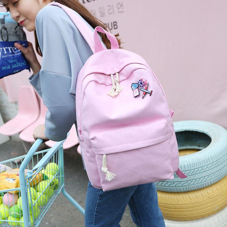 厂家直销新款韩版帆布纯色双肩包女士胸针时尚书包户外休闲背包